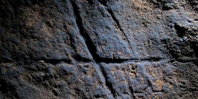 Gorham cave engraving